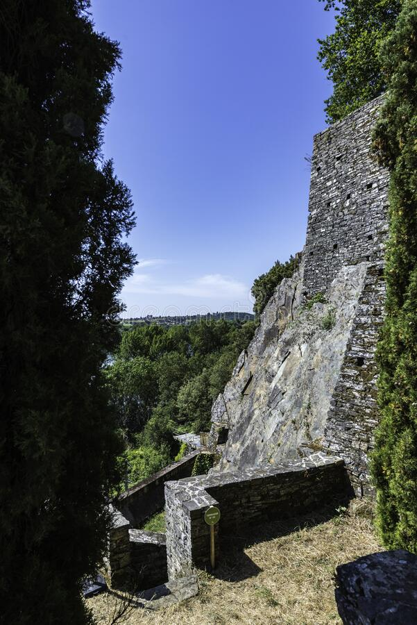 Built by the hand of man. Le Cellier, Loire-Atlantique, France - July 06, 2019: From a terrace located high up, view of a rocky pan where exposed stone walls and royalty free stock photo