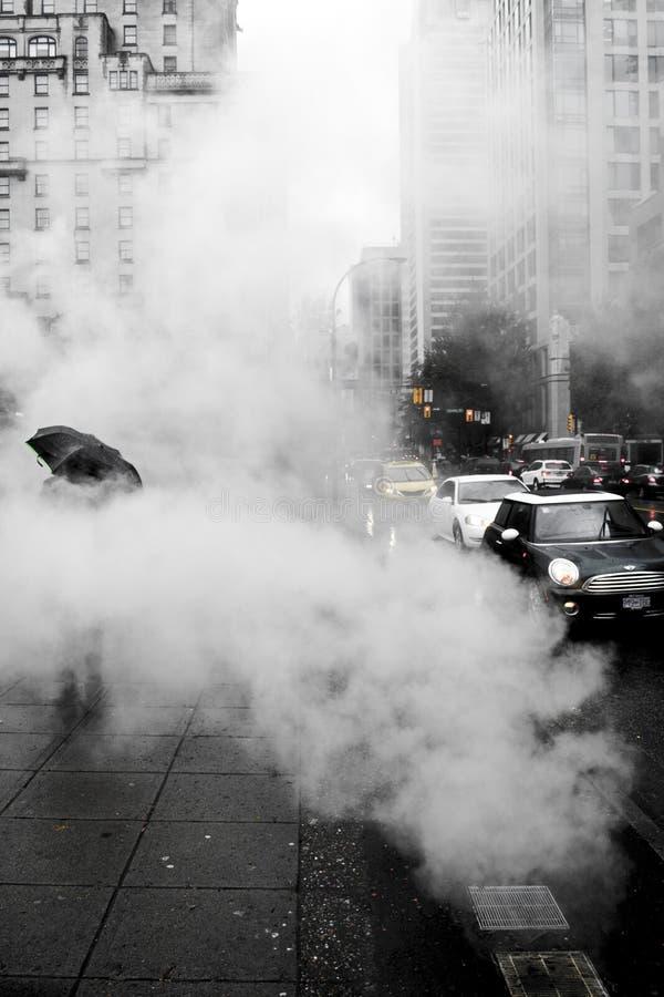 Le centre ville chaud et humide photo stock