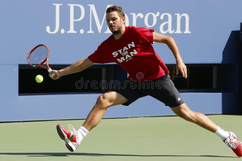 Le champion Stanislas Wawrinka de Grand Chelem pratique pour l'US Open 2014 chez Billie Jean King National Tennis Center photo stock