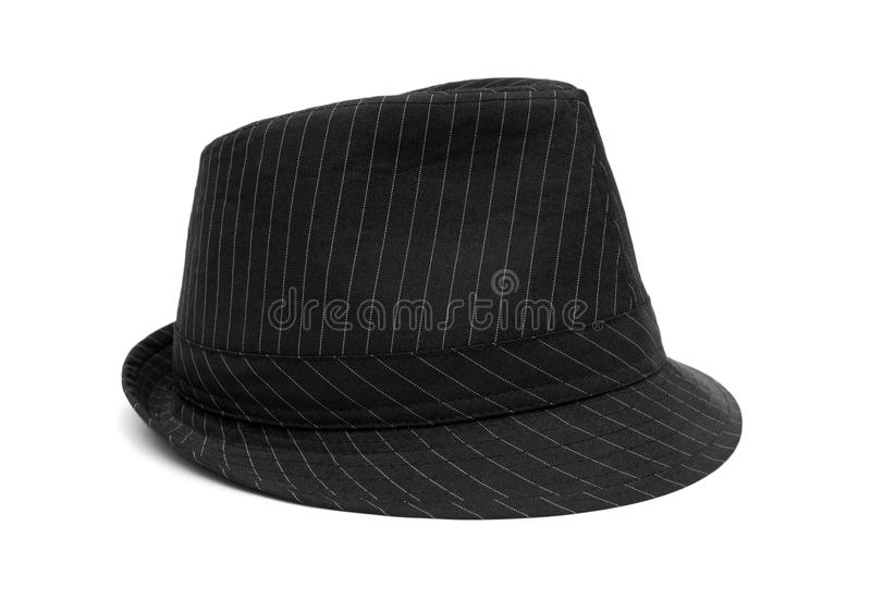 Le chapeau noir avec les pistes blanches a isolé photographie stock libre de droits