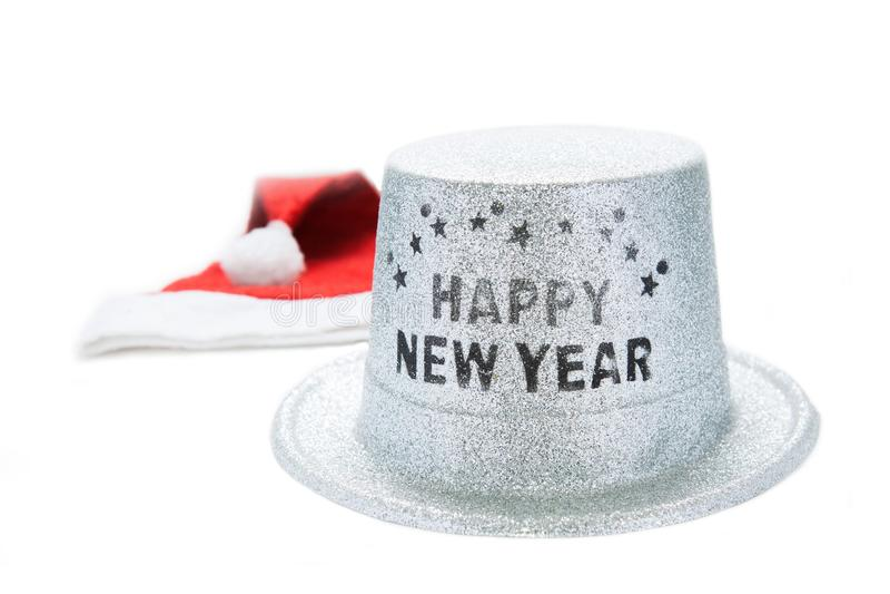 Le chapeau rouge de Santa Claus et la bonne année métallique argentée font la fête le chapeau photos libres de droits