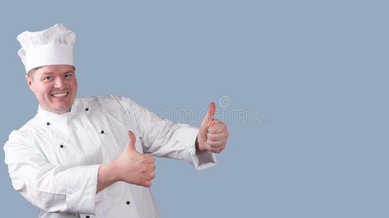 Le chef tient son pouce  image stock