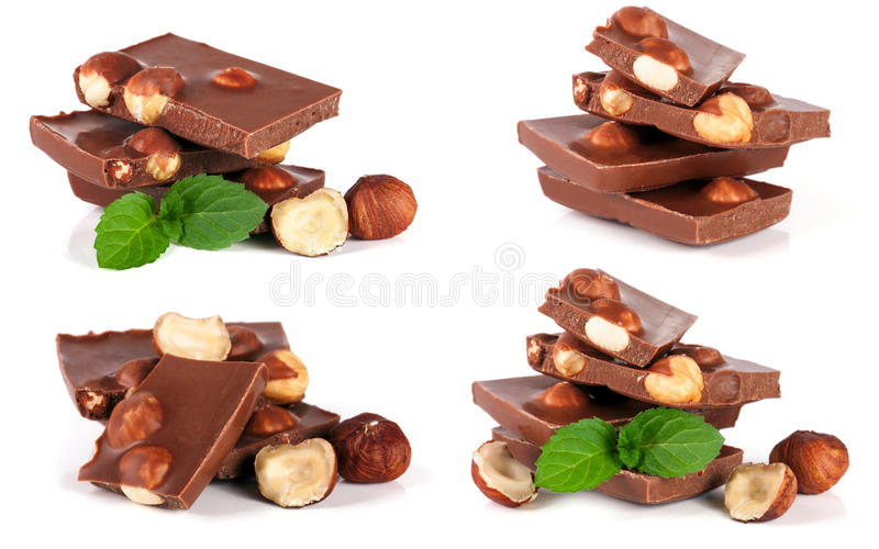 Le chocolat avec la noisette et la menthe poussent des feuilles d'isolement sur le fond blanc Ensemble ou collection photo stock