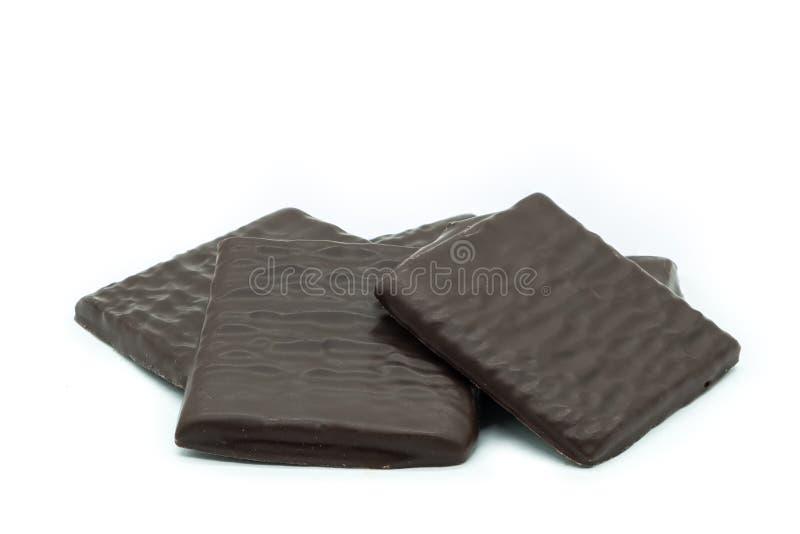 Le chocolat cinq amincit sur le fond blanc photographie stock
