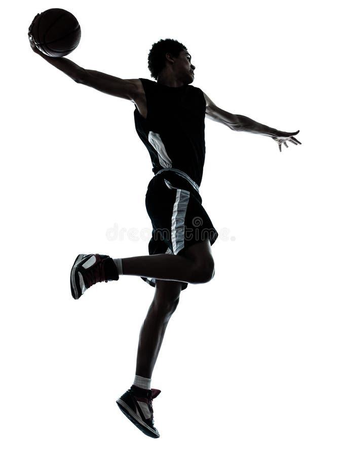 Le claquement de main du joueur de basket un trempent la silhouette images libres de droits