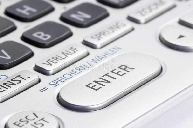 Le clavier numérique avec INTRODUISENT la clé photographie stock libre de droits