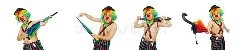 Le clown avec le parapluie d'isolement sur le blanc photographie stock