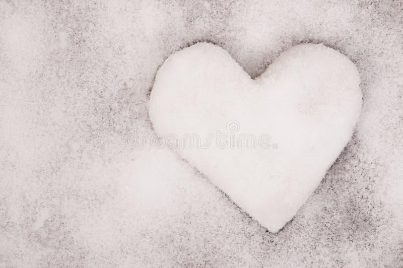 Le coeur de neige photographie stock