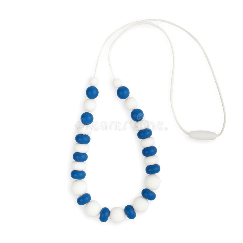 Le collier de dentition de bébé, le collier de mère de soins de perles et les enfants jouent photos libres de droits