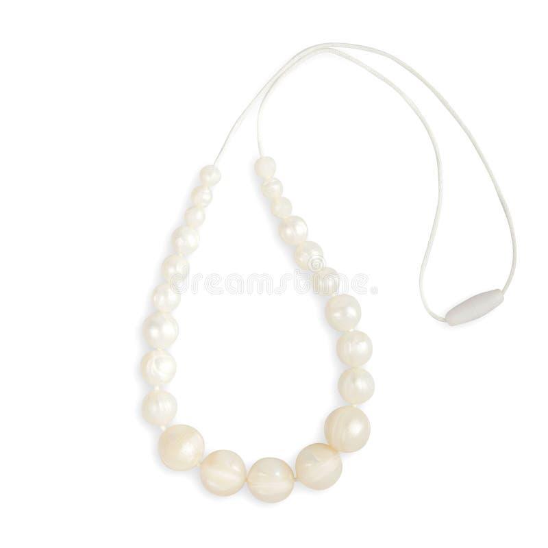 Le collier de dentition de bébé, le collier de mère de soins de perles et les enfants jouent image stock