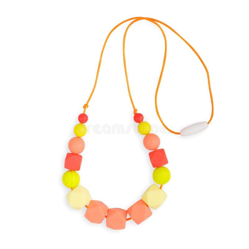 Le collier de dentition de bébé, le collier de mère de soins de perles et les enfants jouent photographie stock