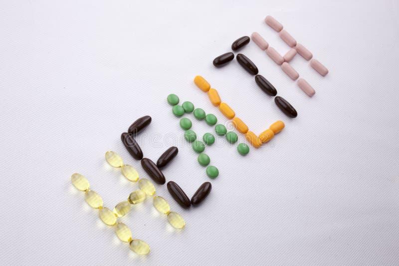 Le concept conceptuel de santé de soins médicaux d'inspiration de légende des textes d'écriture de main écrit avec des pilules do photos stock