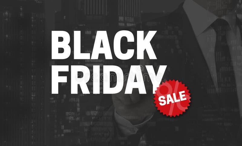 Le concept de Black Friday est montré par l'homme d'affaires photographie stock libre de droits