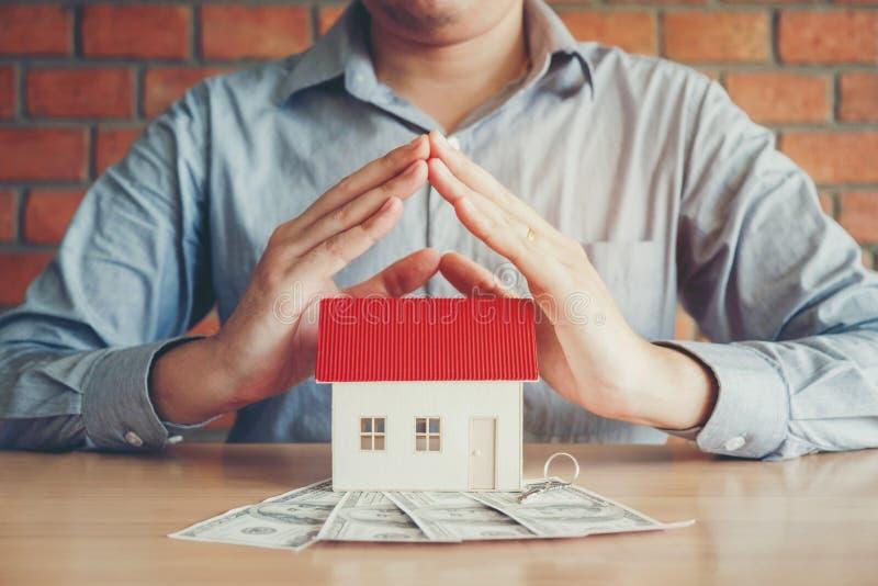 Le concept du propriétaire de logement et de billets d'un dollar images libres de droits
