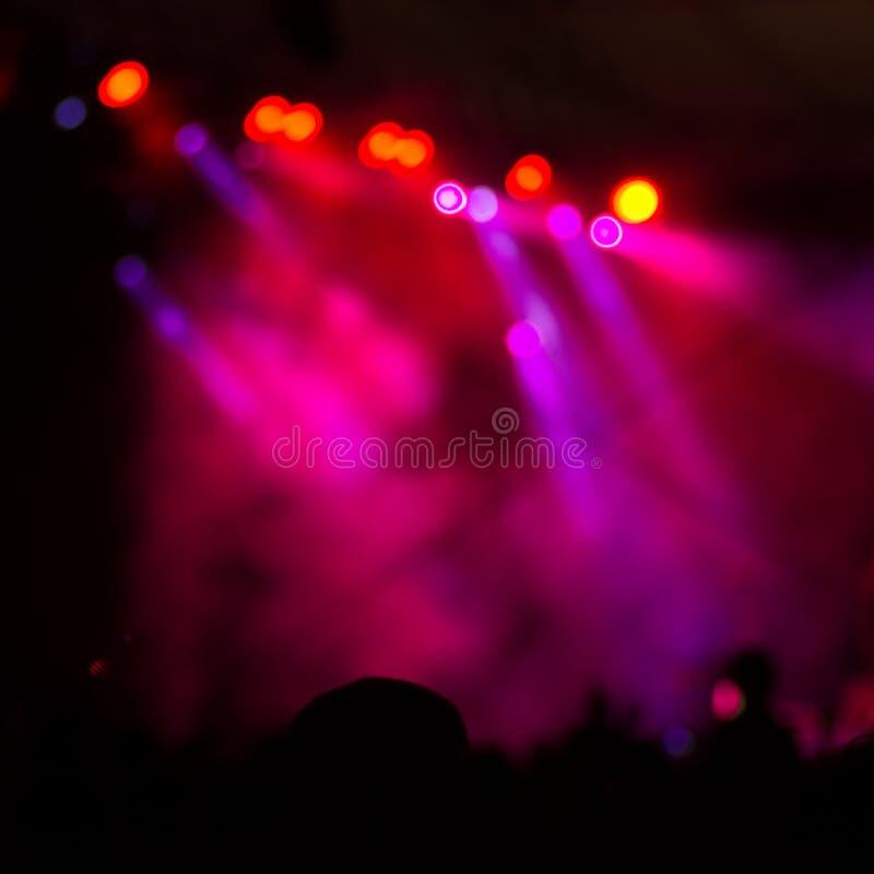 Le concert de tache floue allume le fond photo stock