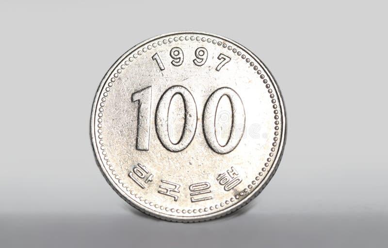 Le Coréen 100 a gagné la pièce de monnaie photo libre de droits