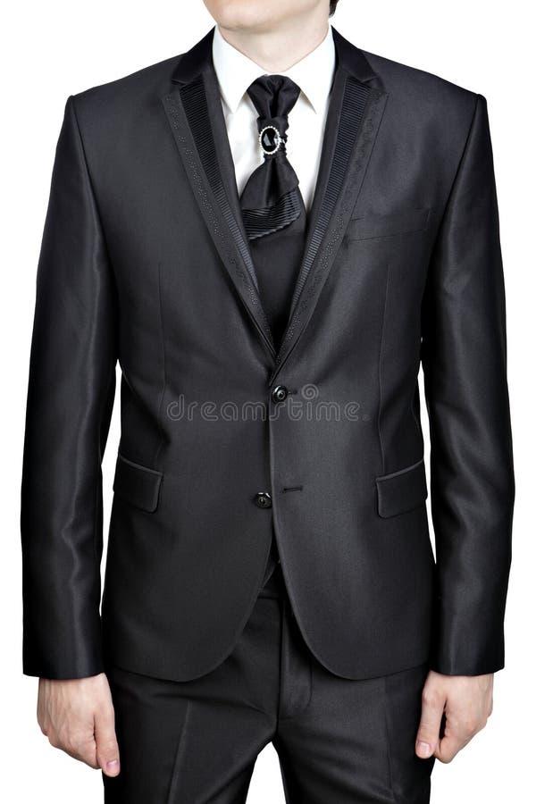 Le costume de noir de la soirée des hommes, noeud de lien a décoré la grande broche de goupille photos stock