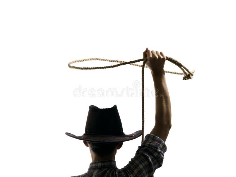 Le cowboy jette un lasso image libre de droits
