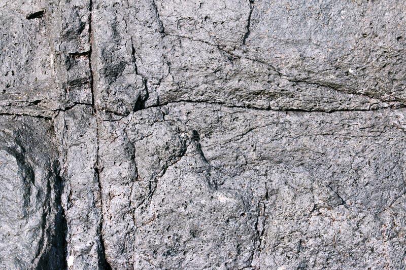 Le crepe e si dissolve nella lava raffreddata fotografie stock