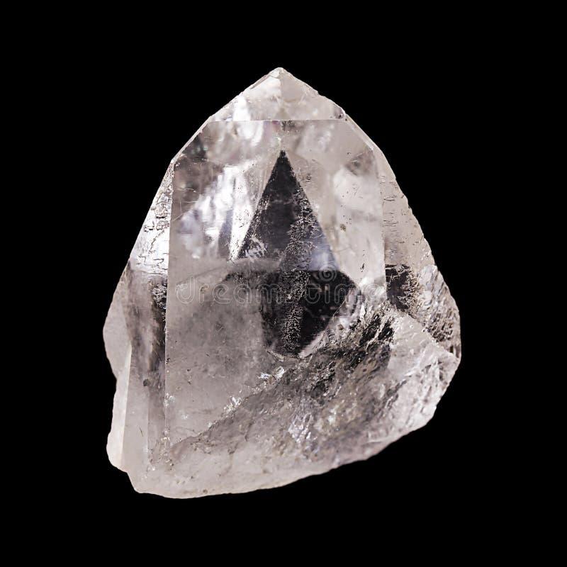 Le cristal de quartz rugueux avec la pyramide a formé l'illusion optique photos stock