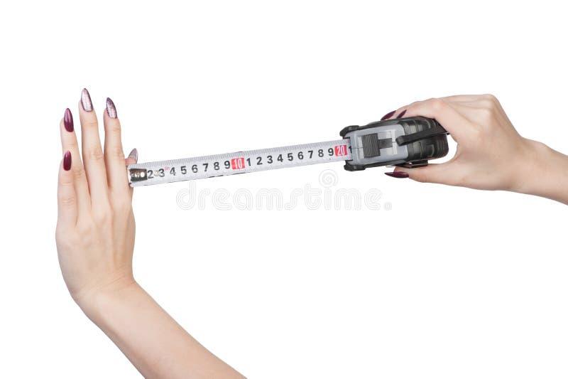 Le critère de mesure est les mains femelles photos stock