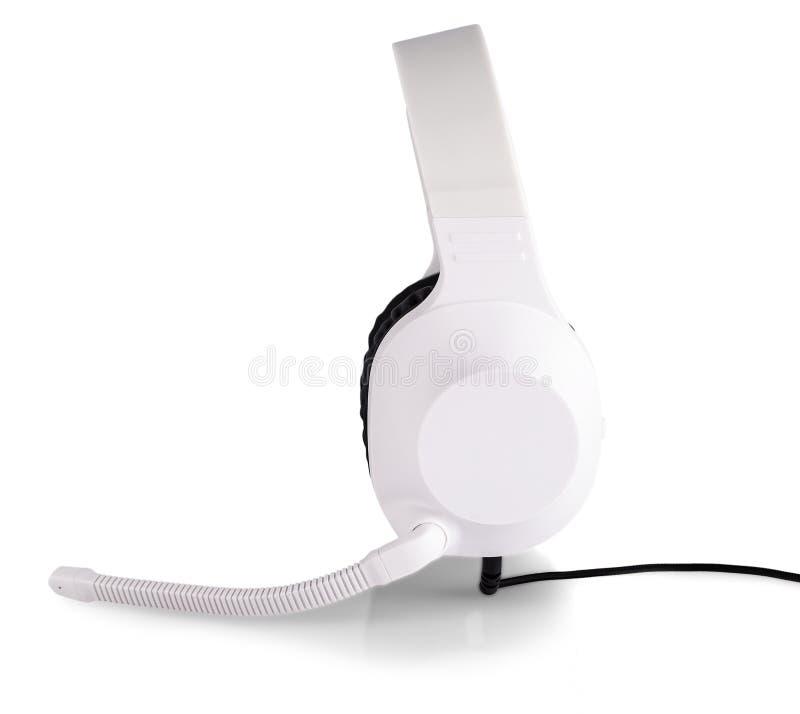 Le cuffie bianche con un microfono isolato su fondo bianco fotografie stock libere da diritti