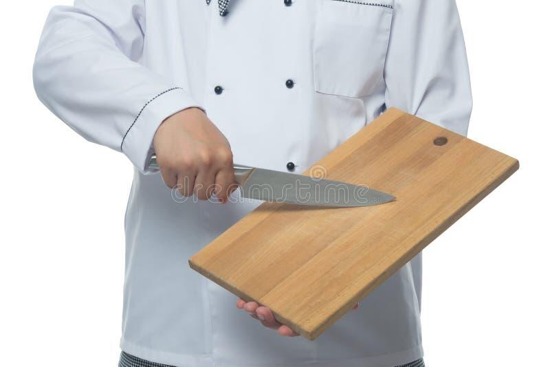 Le cuisinier montre le conseil et un couteau dans les mains de photographie stock