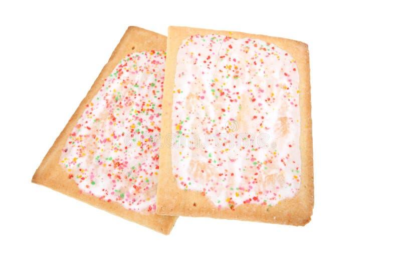 le déjeuner a givré les pâtisseries d'isolement photo libre de droits