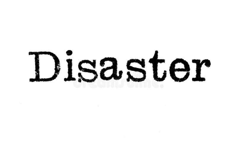 Le ` de catastrophe de ` de mot d'une machine à écrire sur le blanc photographie stock