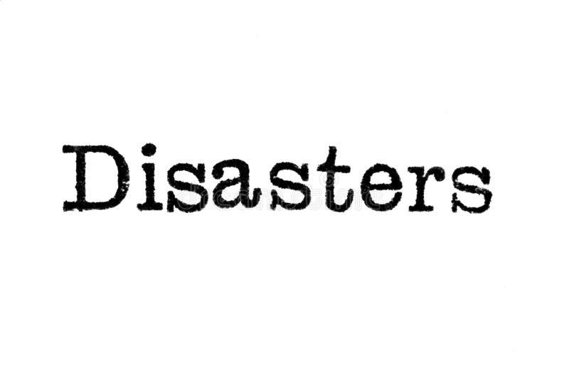 Le ` de catastrophes de ` de mot d'une machine à écrire sur le blanc photos libres de droits