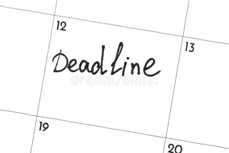 Le ` de date-butoir de ` est le texte écrit sur le calendrier avec un marqueur noir images libres de droits