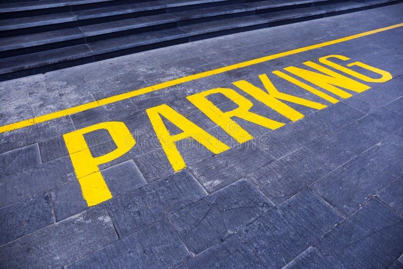 Le ` de stationnement de ` de mot peint en jaune images libres de droits