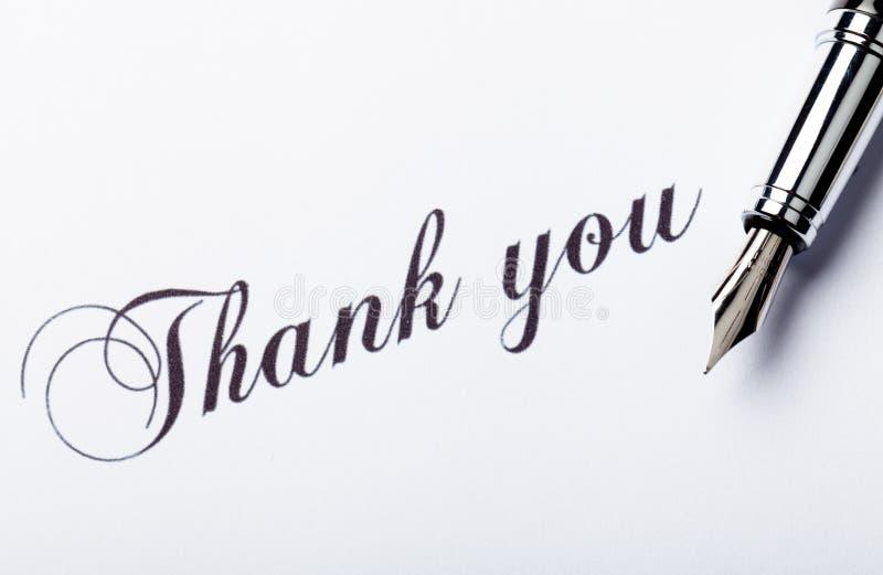 Le ` de stylo-plume et d'inscription de point d'iridium remercient photos libres de droits