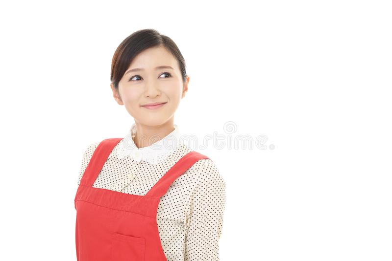Le den asiatiska hemmafrun royaltyfri foto