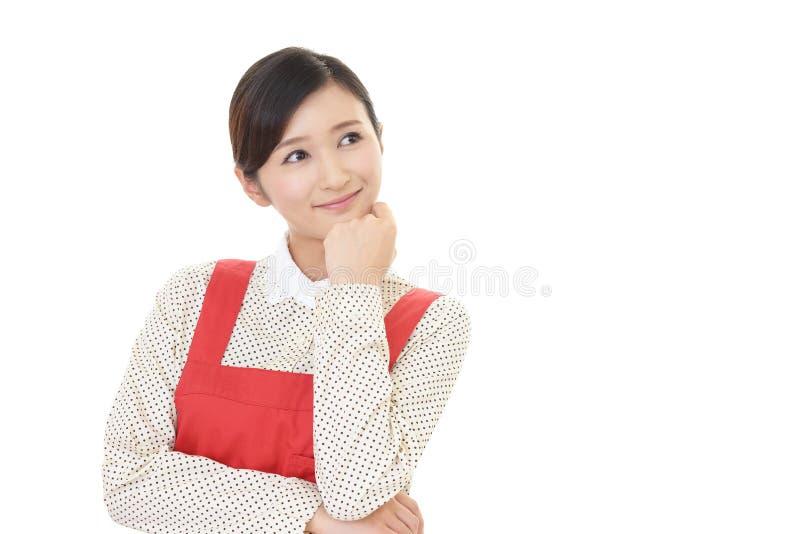 Le den asiatiska hemmafrun arkivfoto