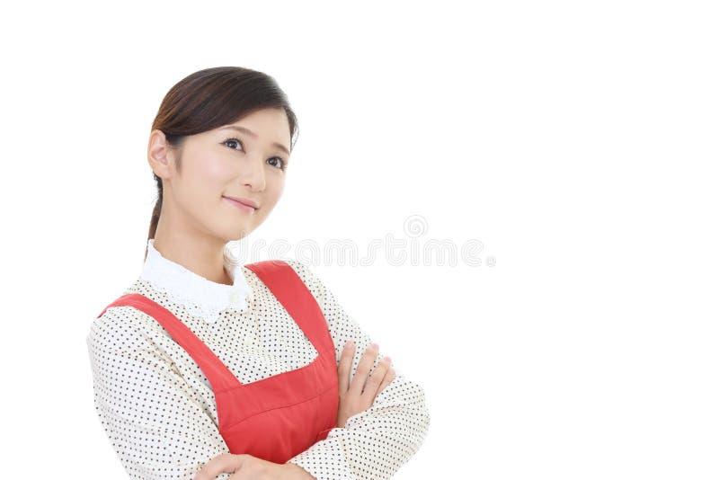 Le den asiatiska hemmafrun arkivbilder