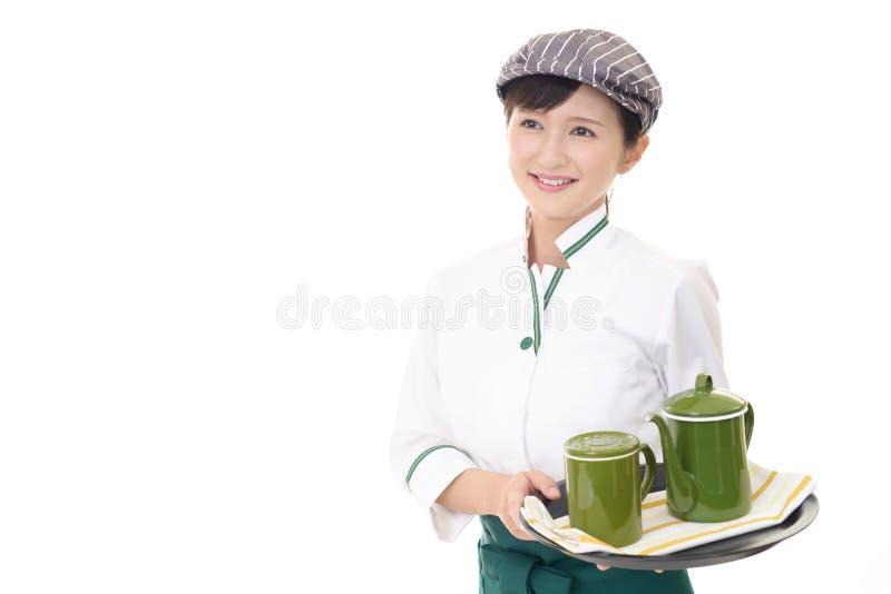 Le den asiatiska servitrins arkivfoto