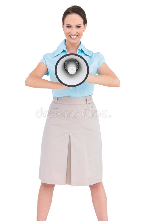 Le den hållande megafonen för flott affärskvinna royaltyfri bild