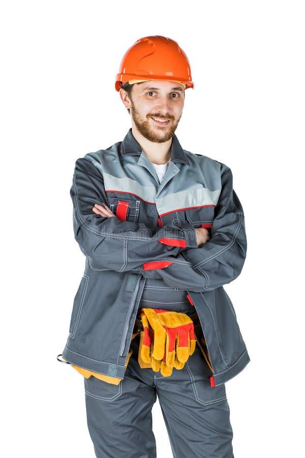 Le den unga byggmästaren som ser kameran Reparation och constructio royaltyfria bilder