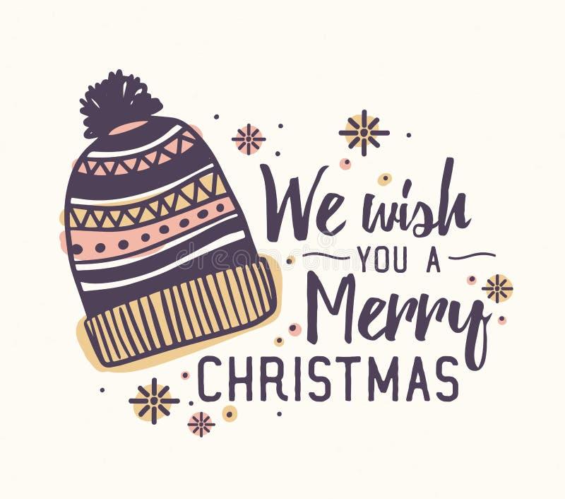 Le deseamos letras de la Feliz Navidad escritas con la fuente elegante y adornadas por el sombrero y los copos de nieve de lana h ilustración del vector