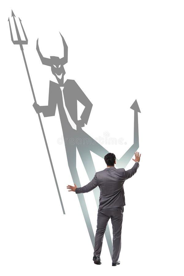 Le diable se cachant dans l'homme d'affaires - concept d'alter ego images stock