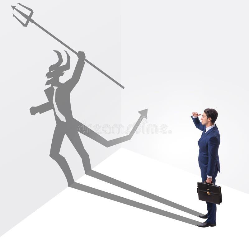 Le diable se cachant dans l'homme d'affaires - concept d'alter ego image libre de droits