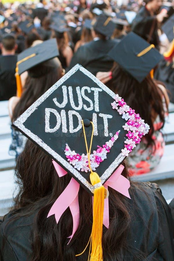 Le diplômé d'université a le message spécial sur la taloche photographie stock