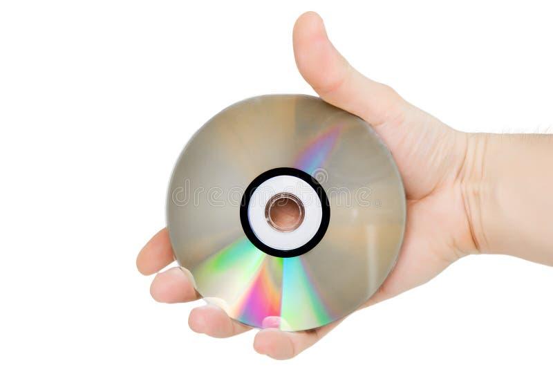Le disque (CD) simple de DVD se retiennent à disposition. image stock