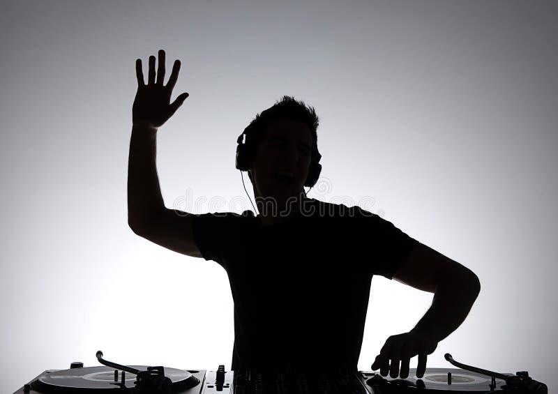 Le DJ silhouettent. photo libre de droits