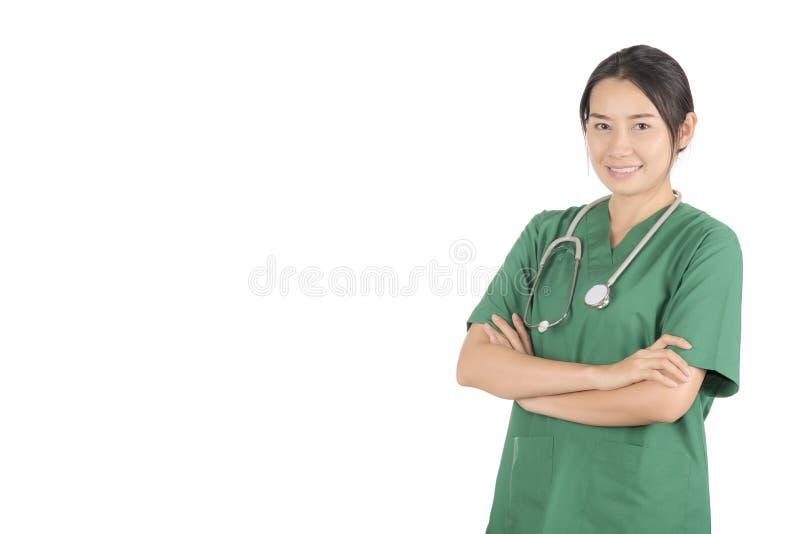 Le docteur féminin de portrait portant un vert frotte et stéthoscope photographie stock