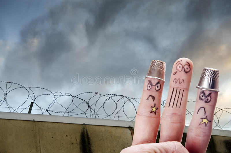 Le doigt est captif photos stock