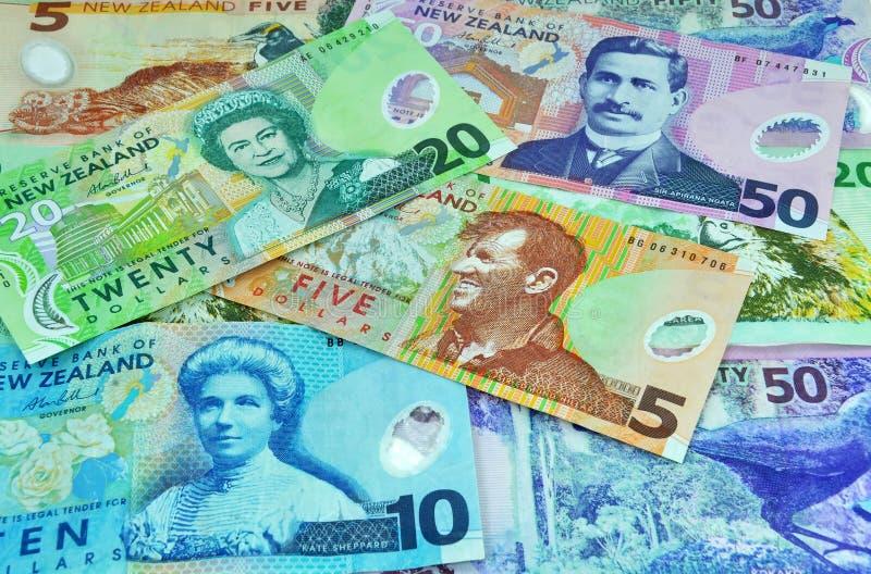 Le dollar de devise de la Nouvelle Zélande note l'argent image stock
