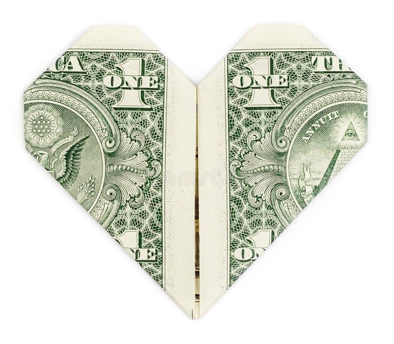 Le dollar s'est plié dans le coeur image libre de droits