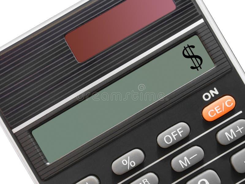 Le dollar se connectent la calculatrice photographie stock